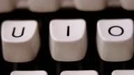 Finger typing letter I on old, retro typewriter. video
