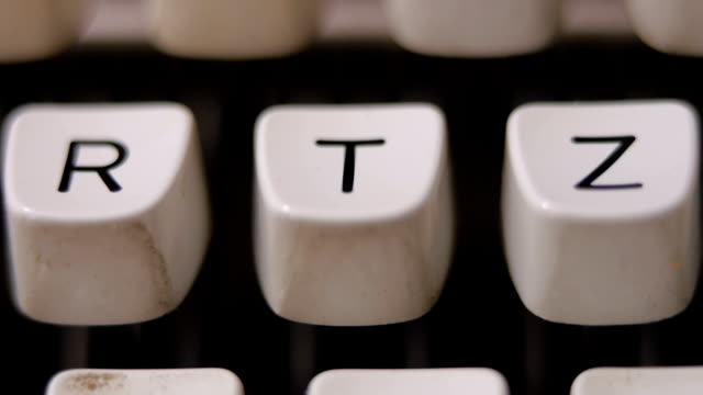 Finger typing letter T on old, retro typewriter. video