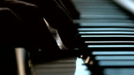 Fingers playing on the keys of a piano video