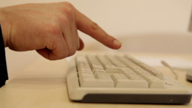 Fingers tapping on a computer keyboard video