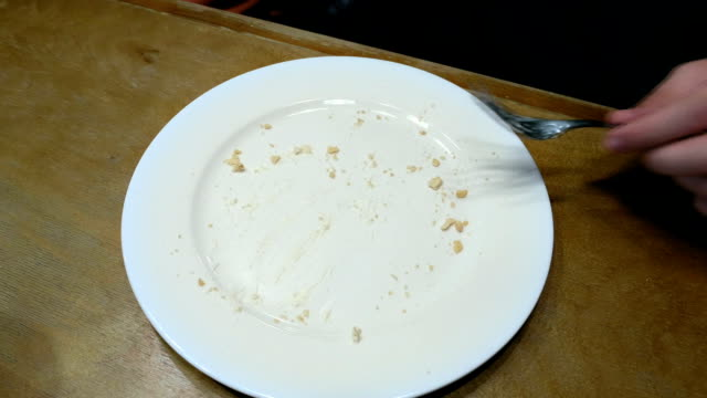 Finish to eat and put fork knife napkin on a plate video