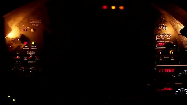 Fire alarm signal blinking red on dark cockpit panel, smoke spreading in cockpit video