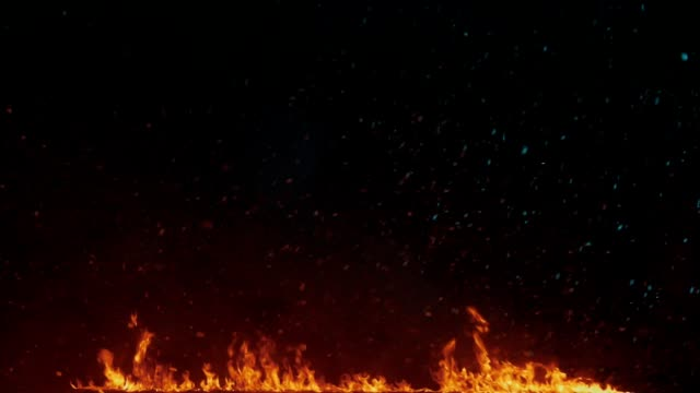 Fire background. Flames background. Snow flakes falling on fire flames video