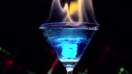 Fire blowing out of blue lagoon glass video
