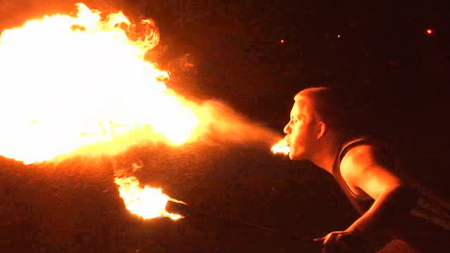 Fire Breather / Breathing Performer blow flames from mouth video
