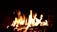 Fire burns in a fireplace video