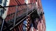 Fire escape on red brick building facade video