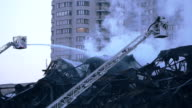 Fire fighter during intense fire extinguishment video