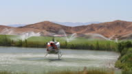 Fire Fighting Helicopter Fills Up At Pond Then Flys Away video