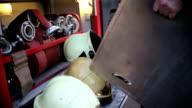 Fire helmets with working fireman. video