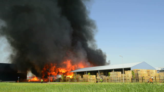 Fire in a warehouse in an industrial area video