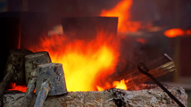 Fire in blast furnaces. Processing steel in iron foundry plant. video
