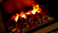 Fire in the fireplace on black background video