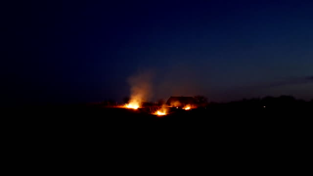 Fire on the farmers field at night video