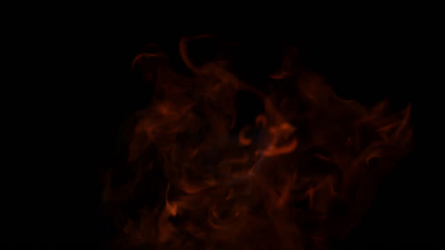 SLO MO of fire tongues emerging from black background video
