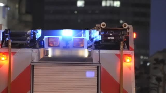 Fire Truck at night, raining, city background (HD720p) video