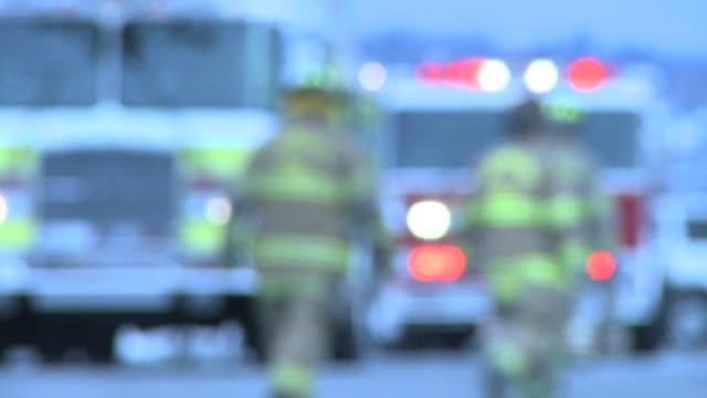 Fire Trucks & Firemen Defocused video