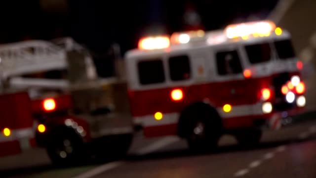 Fire trucks parked in a street background video