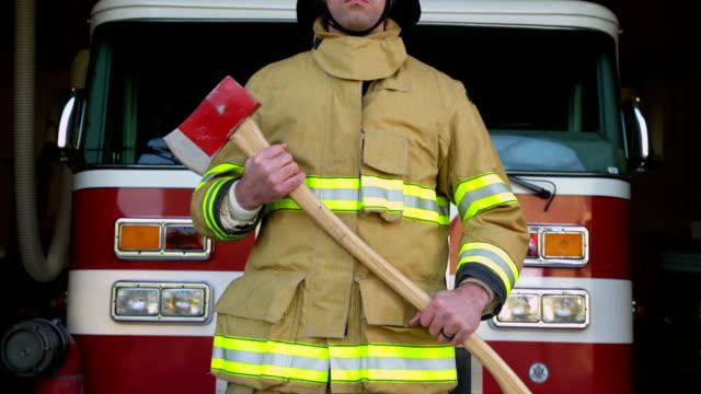 Firefighter portrait in front of firetruck video