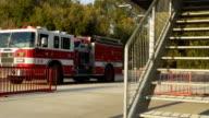 Firefighters arrive in firetruck video