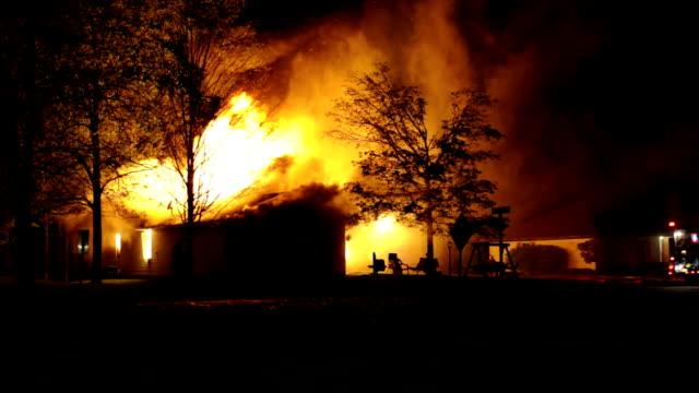 Firefighters battle blaze at night video