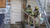 Firefighters enter burning home video