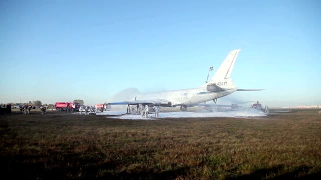 Firefighters extinguish the fire in the airport video