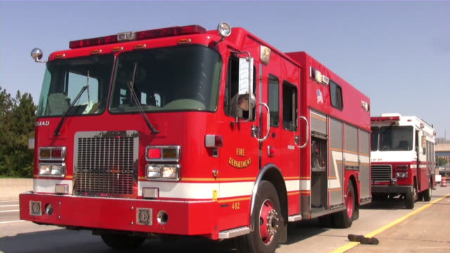 Firefighters, fire trucks on emergency site. Rescue mission, highway accident. video