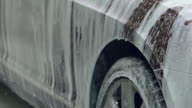 Firefighting foam sprayed over auto dropping off vehicle at car accident site video