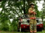 Fireman talks on his radio video