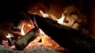Fireplace, burning logs. video