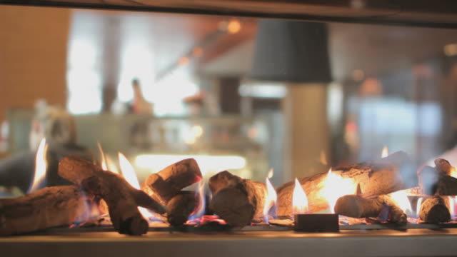 Fireplace in restaurant, Closeup video