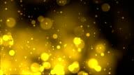 Fireworks bokeh on gold background video