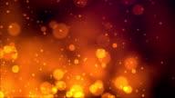 Fireworks bokeh on orange background video