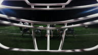 First person point of view from inside a football player's helmet, as the player makes a touchdown video