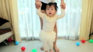 first steps of little asia girl in house video
