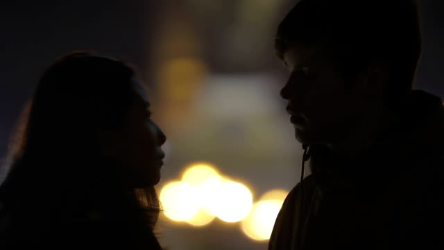 First timid kiss of teenage couple at romantic date, happy love story beginning video