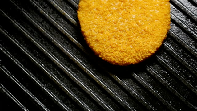 Fish cutlets cooking on grill. video
