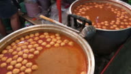 Fish meatball curry soup for rice noodles , Bangkok , Thailand. video