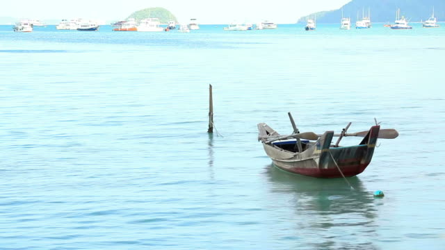 Fisherman boat  floating in Chalong Bay Beach Phuket Thailand video