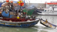 fisherman boat tows another boat to sea, essaouira, morocco video