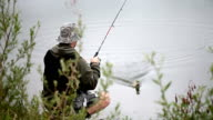 Fisherman catching pike video