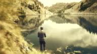 Fisherman fly fishing at lake video
