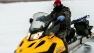 Fisherman on a snowmobile video