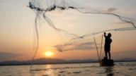 Fisherman on longtail boat fishing video