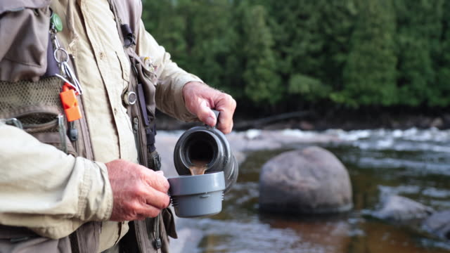 Fisherman Pouring a Coffee Cup in Nature video