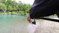 Fisherman reeling at beautiful creek 4k video