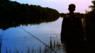 Fisherman Stands on the Riverside. video