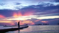 Fisherman throwing nets with beautiful sunset background video