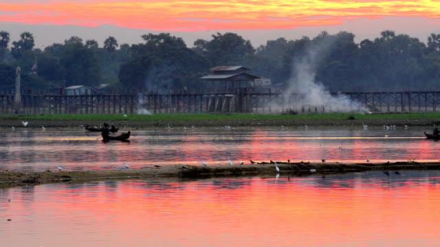 Fisherman working in morning at sunrise,Amarapura, U-Bein bridge, Mandalay, Myan video